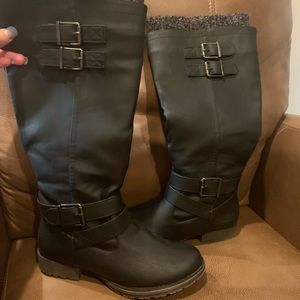 Tall leather black boots